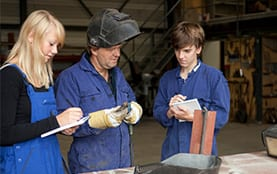 Welder teaching students